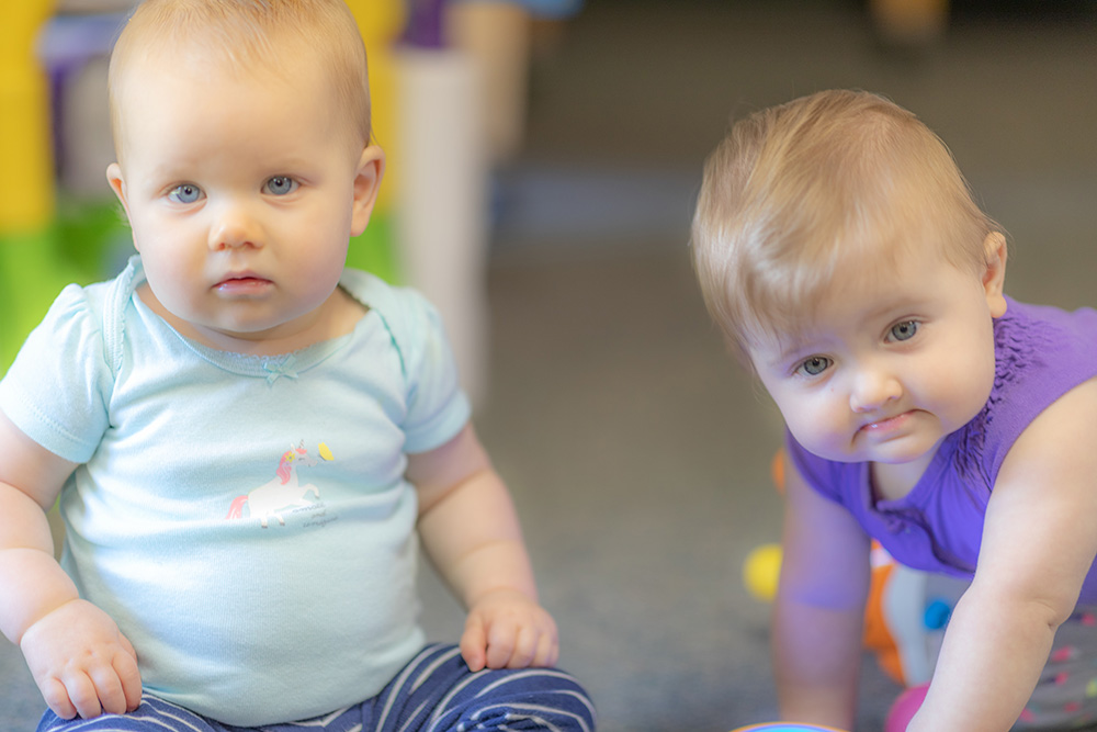 Infants being cared for in a daycare setting
