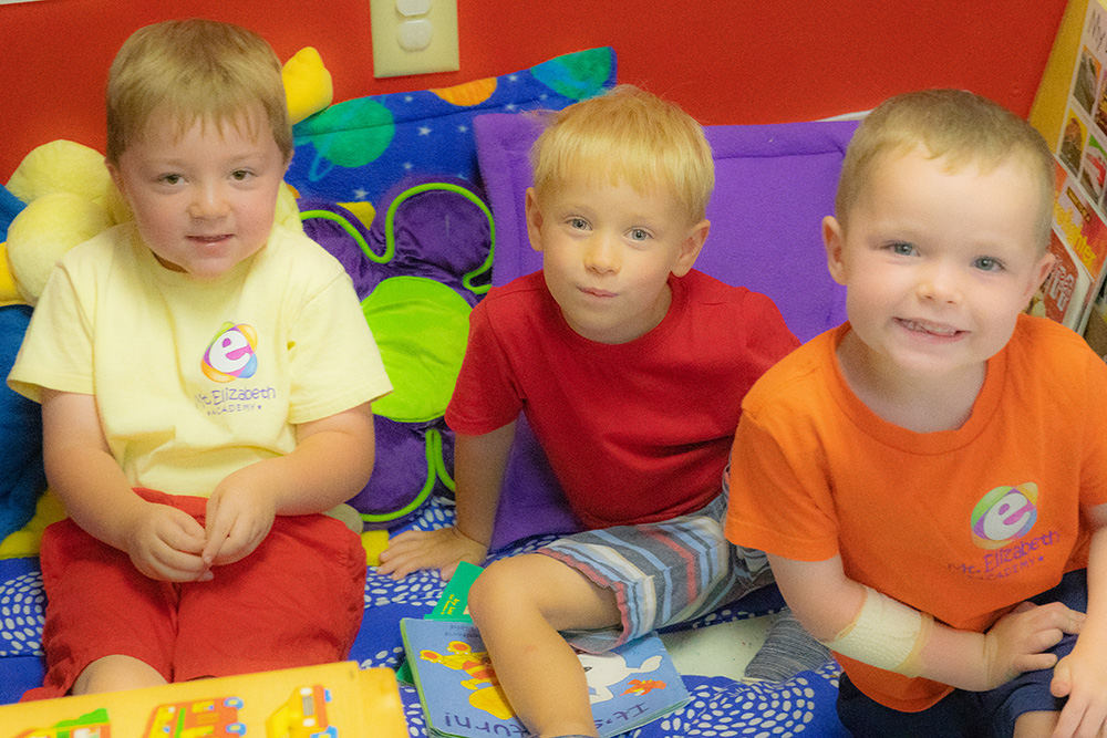 Three boyu learning in Preschool on pillows