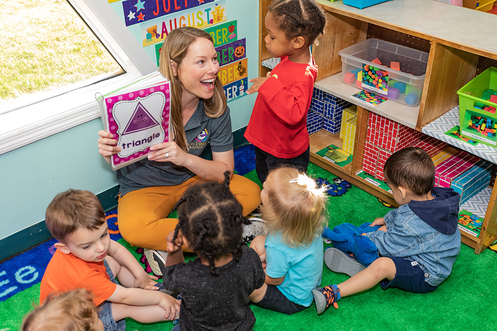 Teacher reading to children on a carpet during circle time