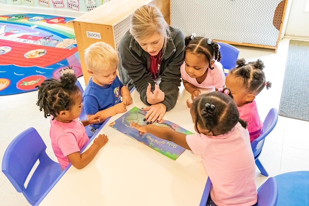 Children with their daycare teacher