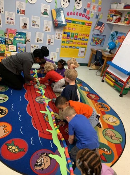 Сhildren play with teacher at Preschool classroom, at Mt. Elizabeth Academy, Daycare, preschool, Kennesaw Christian school, private school