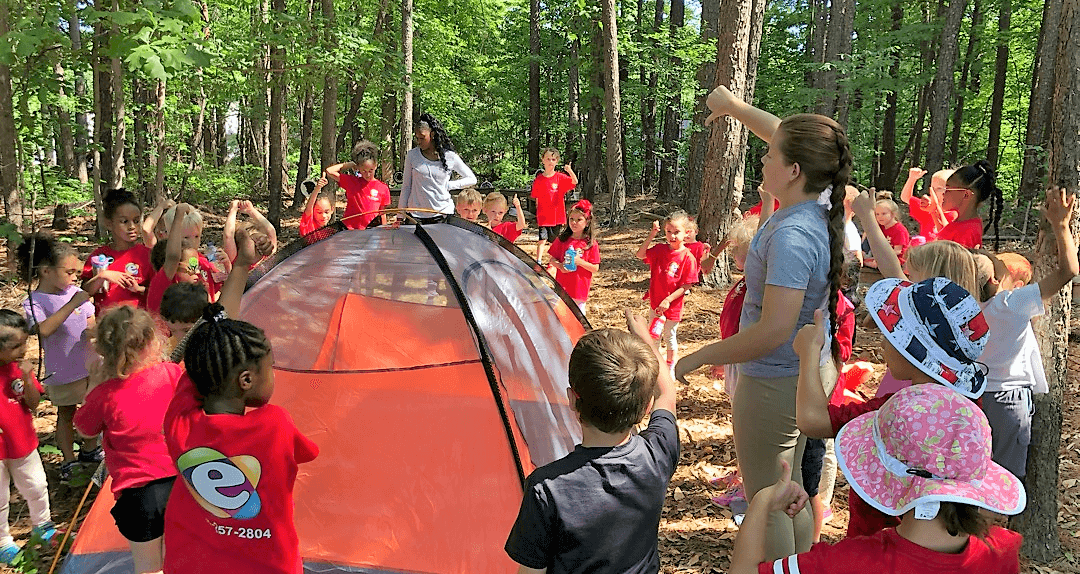 Our vacartion camp kids are setting up a tent on the nature trail at Mt. Elizabeth Academy in Kennesaw, Georgia.